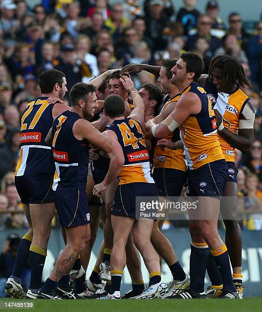 Eagles players congratulate Murray Newman after kicking a goal during the round 14 AFL match between the West Coast Eagles and the Gold Coast Suns at...