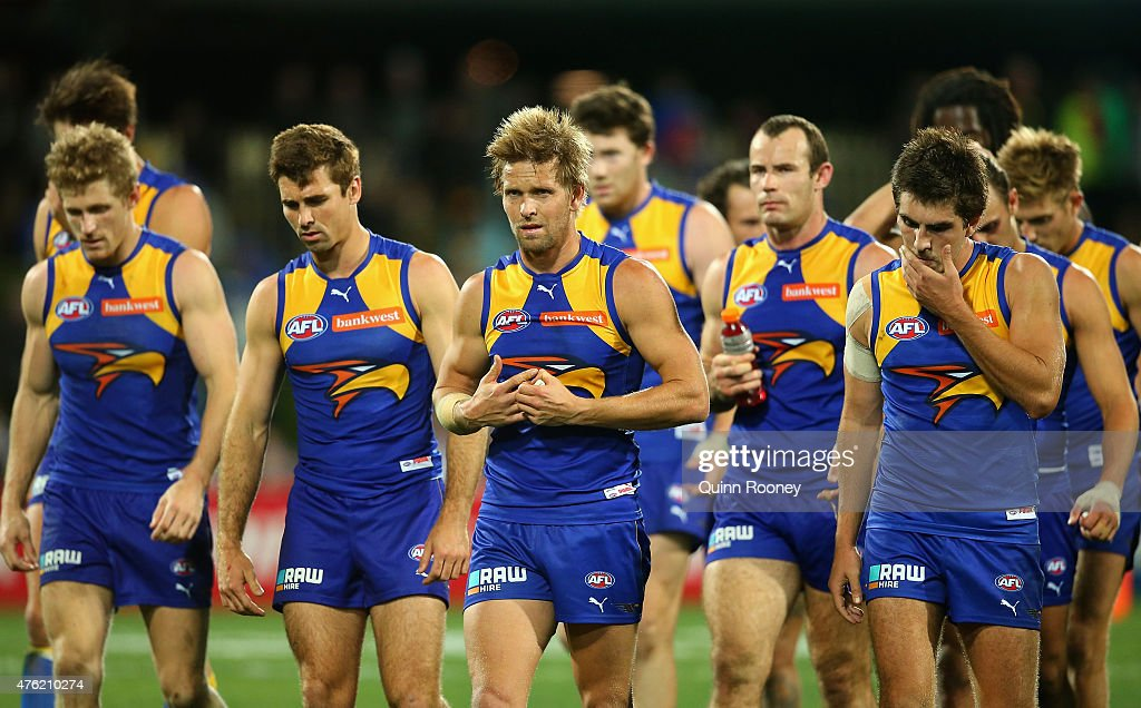 Eagles players look dejected after losing the round 10 AFL match between the North Melbourne Kangaroos and the West Coast Eagles at Blundstone Arena on June 7, 2015 in Hobart, Australia.