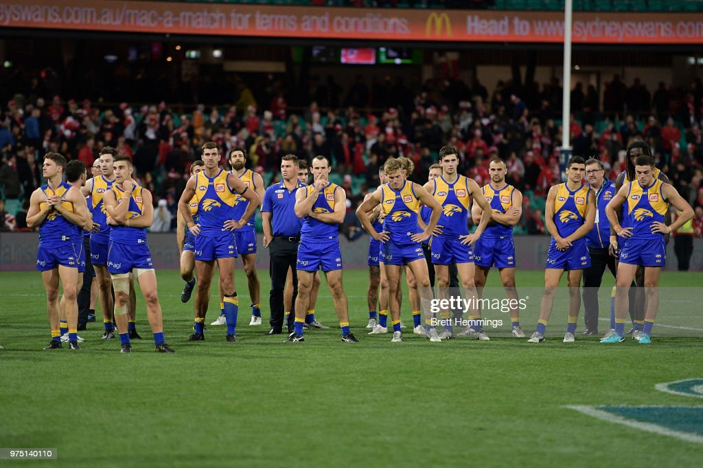 Eagles players show their dejection after defeat during the round 13 AFL match between the Sydney Swans and the West Coast Eagles at Sydney Cricket Ground on June 15, 2018 in Sydney, Australia.
