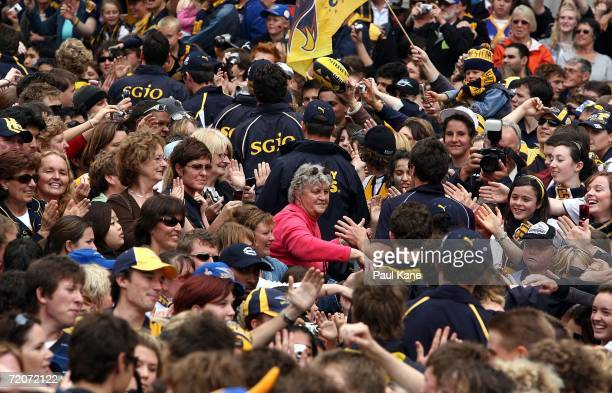 Eagles players walk through a sea of fans as the West Coast Eagles celebrate their AFL Grand Final win at Forest Place October 3 2006 in Perth...