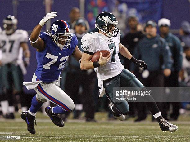 Eagles quarterback Jeff Garcia runs upfield as Giants defensive end Osi Umenyiora pursues during the game between the Philadelphia Eagles and the New...