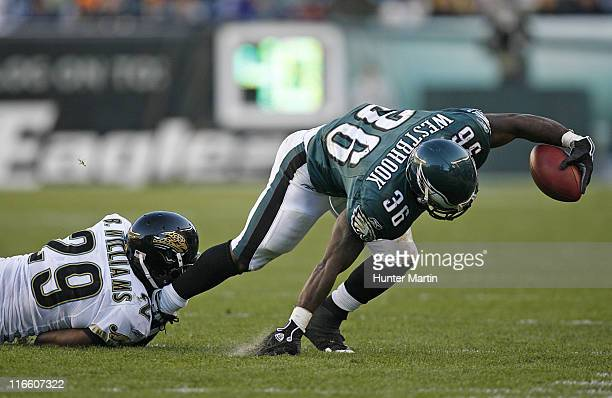 Eagles running back Brian Westbrook tries to get out of bounds while getting tackled by Jaguars corner back Brian Williams during the game between...