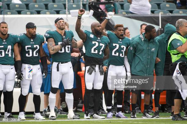 Eagles S Malcolm Jenkins Eagles S Rodney McLeod and Eagles DE Chris Long stand together during the National Anthem before the game between the...