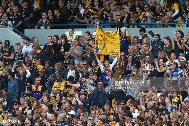 Eagles supporters celebrate a goal during the round 23 AFL match between the West Coast Eagles and the Adelaide Crows at Domain Stadium on August 27...
