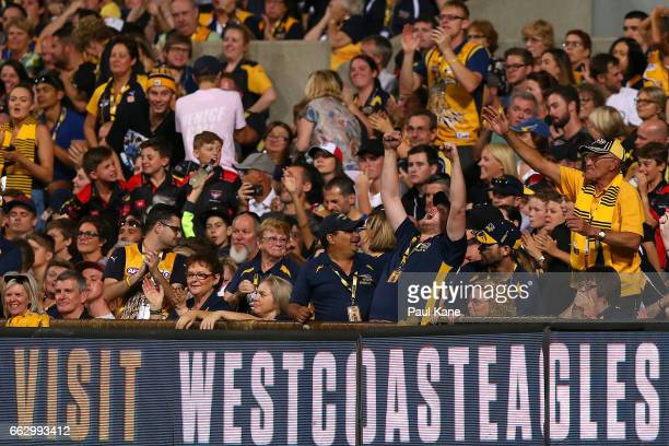 Eagles supporters celebrate a goal during the round two AFL match between the West Coast Eagles and the St Kilda Saints at Domain Stadium on April 1...