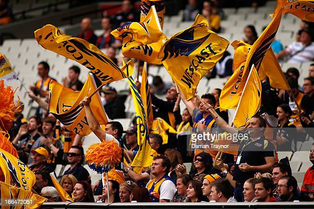 Eagles supporters cheer another goal during the round three AFL match between the Melbourne Demons and the West Coast Eagles at Melbourne Cricket...