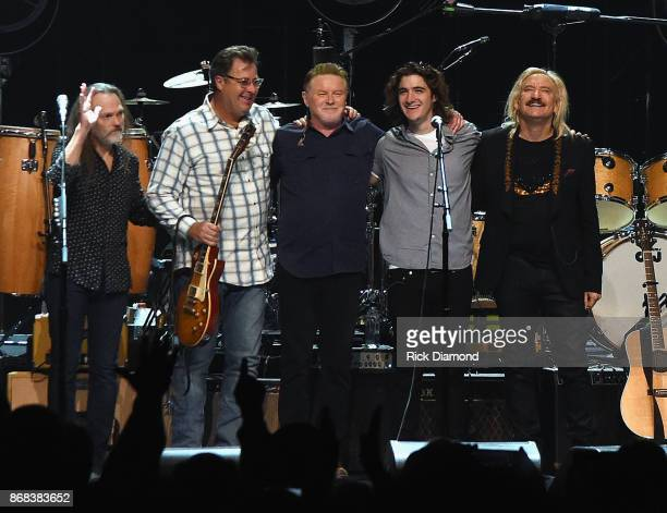 Eagles, Timothy B. Schmit, Vince Gill, Don Henley, Decon Frey and Joe Walsh perform during the Eagles in Concert at The Grand Ole Opry on October 29,...