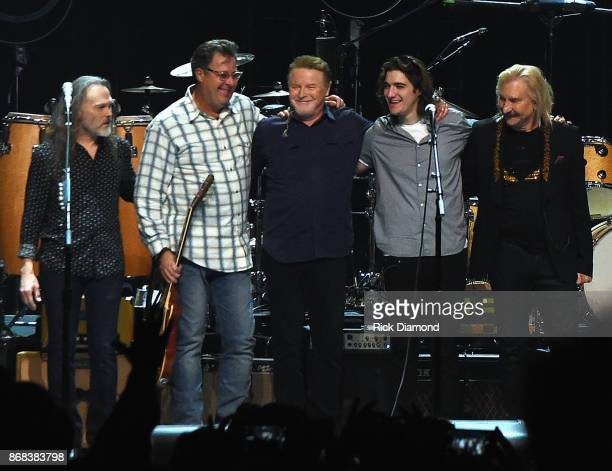 Eagles Timothy B Schmit Vince Gill Don Henley Decon Frey and Joe Walsh perform during the Eagles in Concert at The Grand Ole Opry on October 29 2017...