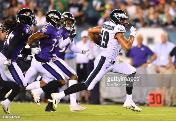 Eagles WR JJ ArcegaWhiteside runs past defenders on a reception in the second half during the Preseason game between the Baltimore Ravens and...
