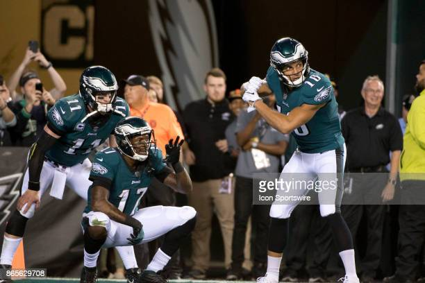 Eagles WR Mack Hollins celebrates with teammates Carson Wentz and Alshon Jeffery after a touchdown in the first half during the game between the...