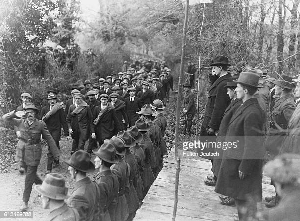 Eamon De Valera inspects members of the Western Division of the Irish Republican Army at Six Mile Bridge County Clare during the Sinn Fein Rebellion