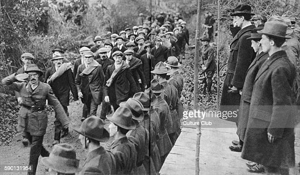Eamon de Valera Irish politician receiving the salute of members of Sinn Fein marching past 1919