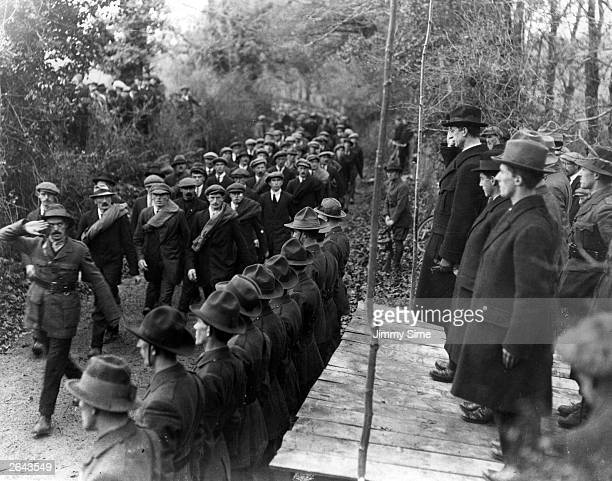Eamon de Valera , leader of Sinn Fein and President of Dail Eireann inspecting the Western Division of the Irish Republican Army at Six Mile Bridge...