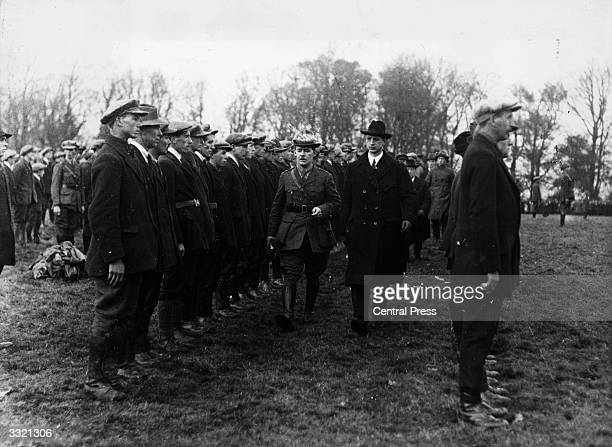 Eamon de Valera leader of Sinn Fein and President of Dail Eireann inspecting the Western Division of the Irish Republican Army at Six Mile Bridge in...