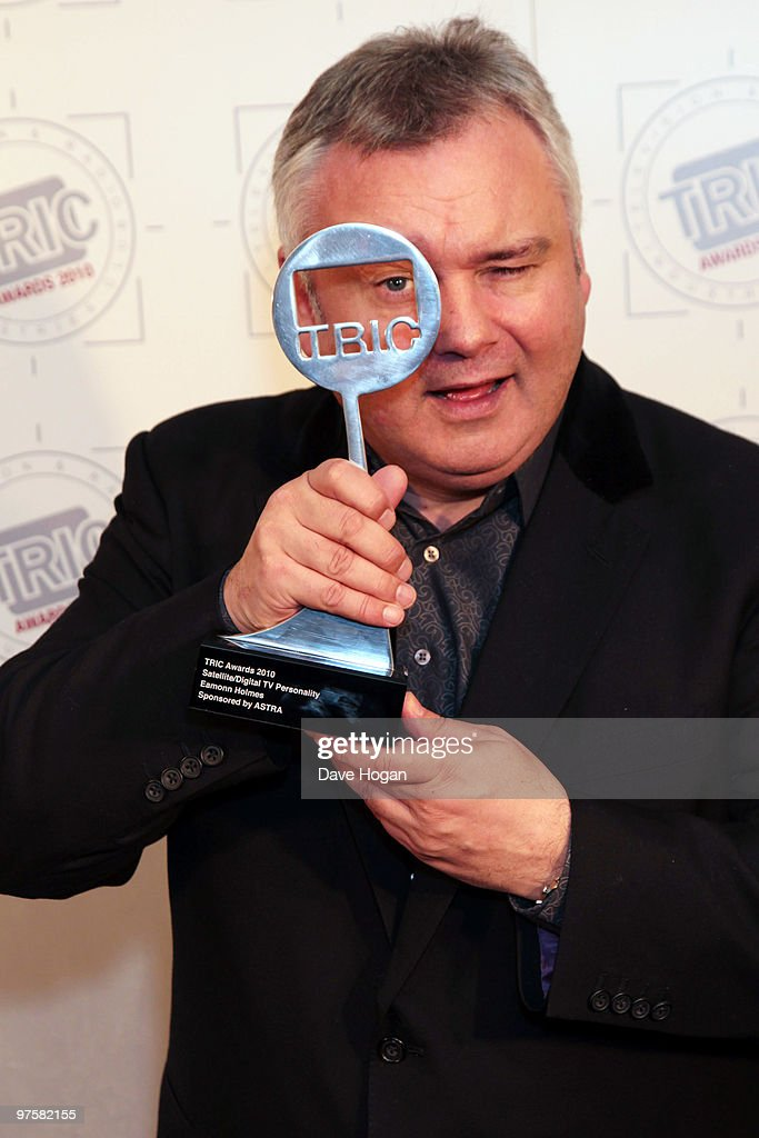 Eamon Holmes poses with his Digital TV Personality award in the press room at the TRIC Awards 2010 held at The Grosvenor House Hotel on March 9, 2010 in London, England.