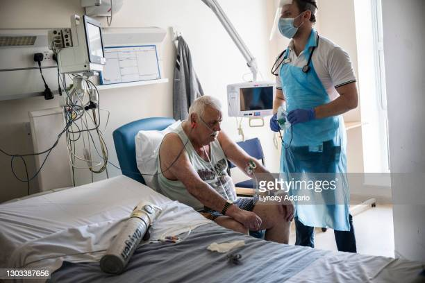 Eamon Nixon 78, tested negative but has all symptoms, suspected COVID-19 in COVID ward being treated by Tom Swindell physiotherapist on May 25, 2020...