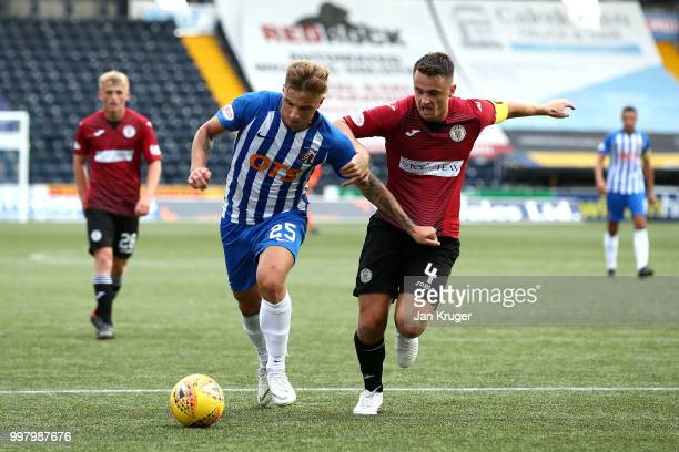 Eamonn Brophy of Kilmarnock FC battles with Stephen McGinn of St Mirren during the Betfred Scottish League Cup match between Kilmarnock and St Mirren...