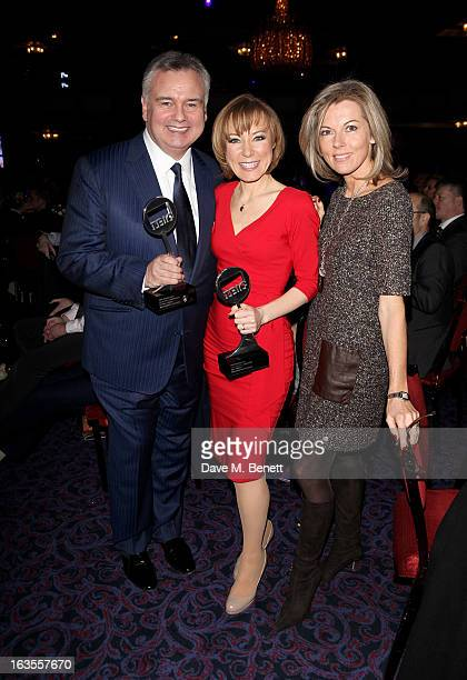 Eamonn Holmes and Sian Williams cowinners of the News Presenter/Reporter award pose with Mary Nightingale at the TRIC Television and Radio Industries...