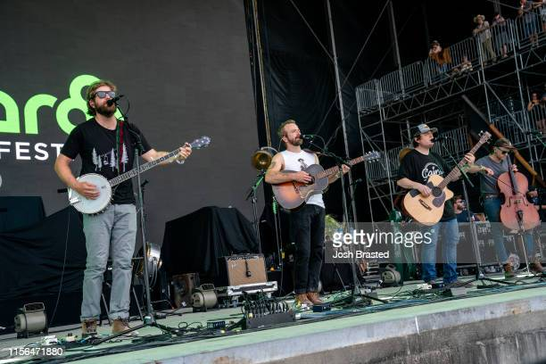 Eamonn McClain Dave Simonett Dave Carroll and Tim Saxhaug of Trampled by Turtles performs during the Bonnaroo Music Arts Festival on June 16 2019 in...