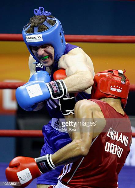 Eamonn of O'Kane of Northern Ireland competes against Anthony Ogogo of England in the Middle Weight Men Finals Gold Medal Bout at Talkatora Indoor...
