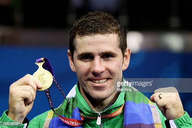 Eamonn of O'Kane of Northern Ireland poses with the gold medal during the medal ceremony for the Middle Weight Men Finals Gold Medal Bout at...