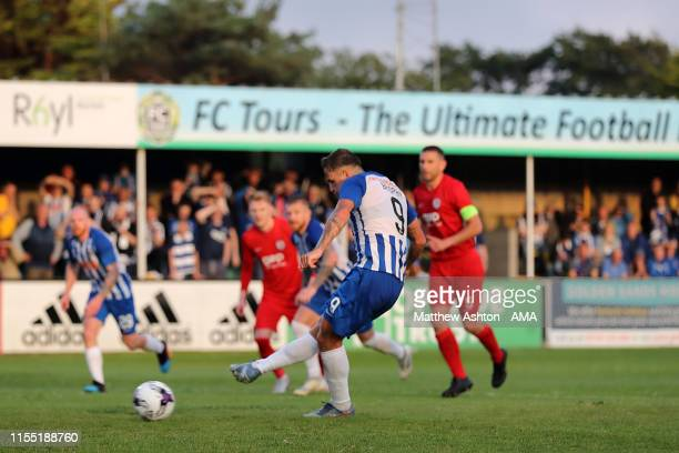 Eamonn Trophy of Kilmarnock scores a penalty to make it 11 during the UEFA Champions League Qualification first leg match between Connah's Quay...