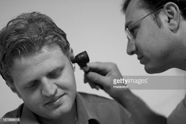 ear exam - infectious disease stock pictures, royalty-free photos & images