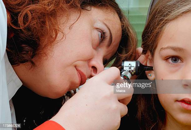 Ear exam with otoscope on a child