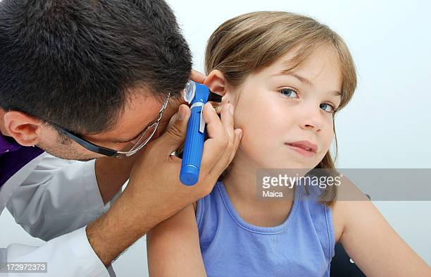 Ear exam with otoscope