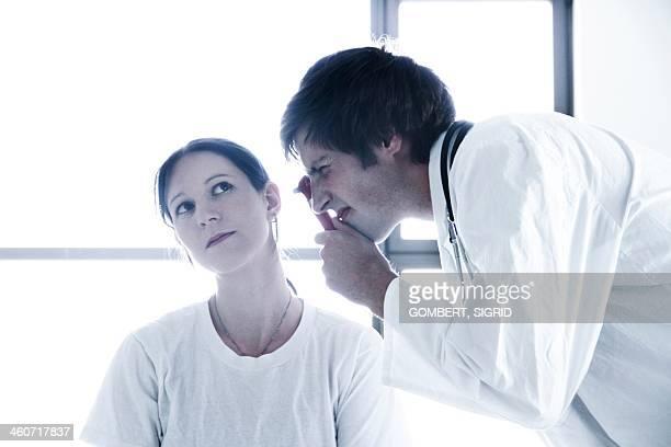 ear examination - sigrid gombert stock-fotos und bilder