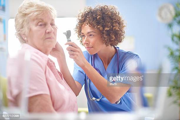 ear examination - ear exam stock photos and pictures