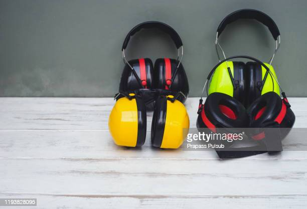 ear muff to protect workers' ears - hearing protection stock pictures, royalty-free photos & images