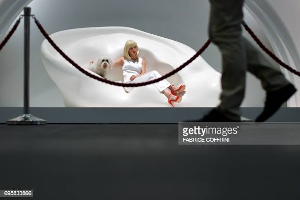 Ear Sofa Noses Sconces with Flowers by US conceptual artist John Baldessari is pictured at Unlimited show during the preview day of Art Basel the...