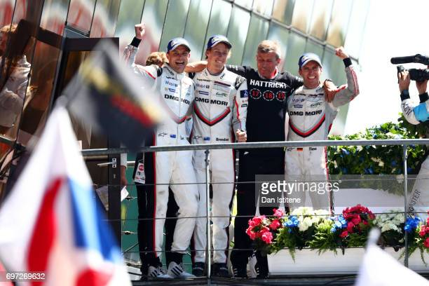 Earl Bamber Brendon Hartley and Timo Bernhard of the Porsche LMP Team celebrate on the podium with Vice President of Porsche's LMP1 Racing Program...