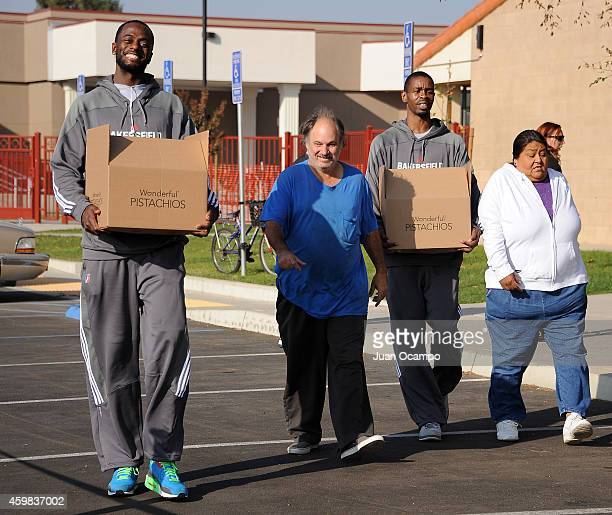 Earl Barron and Renaldo Major of the Bakersfield Jam help carry out Thanksgiving dinner boxes during the Bakersfield Jam Thanksgiving Box Give Away...