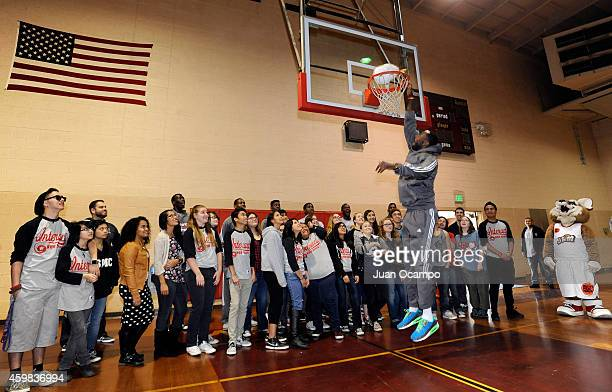 Earl Barron of the Bakersfield Jam dunks a frozen turkey as part of the event's tradition during the Bakersfield Jam Thanksgiving Box Give Away Event...