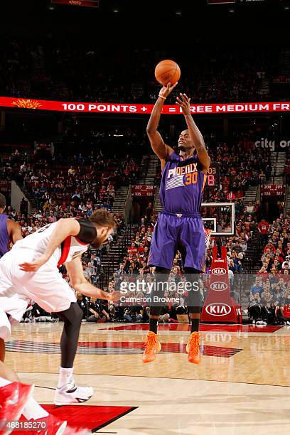 Earl Barron of the Phoenix Suns shoots against the Portland Trail Blazers during the game on March 30 2015 at Moda Center in Portland Oregon NOTE TO...