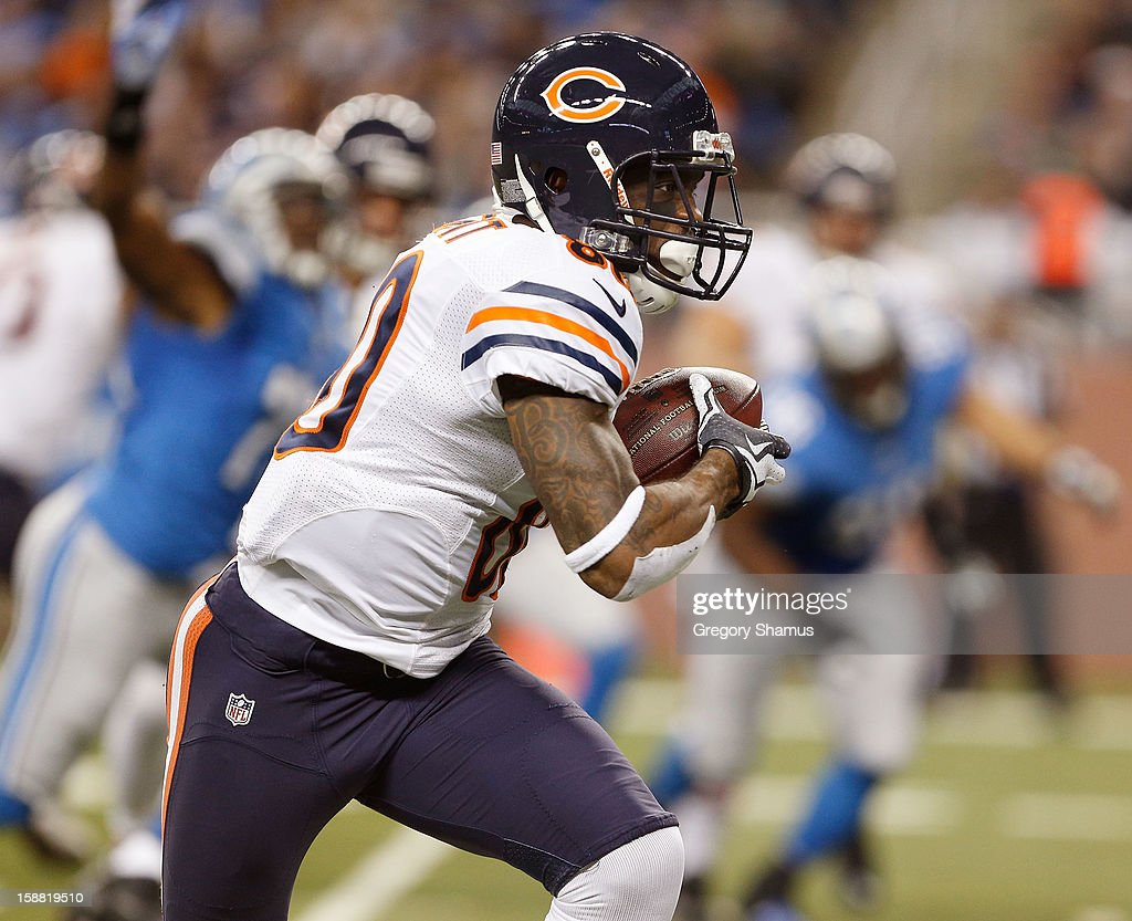 Earl Bennett #80 of the Chicago Bears looks for running room after a third quarter catch while playing the Detroit Lions at Ford Field on December 30, 2012 in Detroit, Michigan. Chicago won the game 26-24.