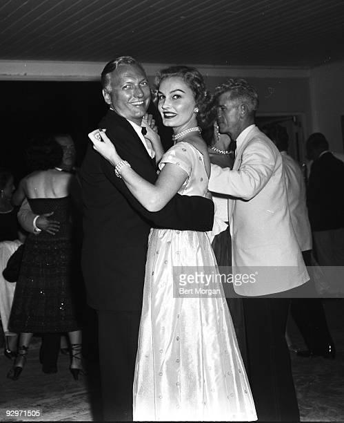 Earl Blackwell and Pamela Curran smiling as the dance at the Palm Beach Polo Club Palm Beach Florida c1955
