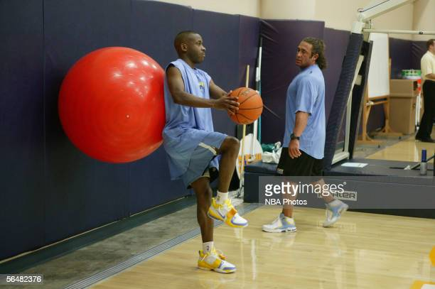 Earl Boykins and strength and conditioning coach Steve Hess of the Denver Nuggets work out at practice at the Pepsi Center on December 22 2005 in...