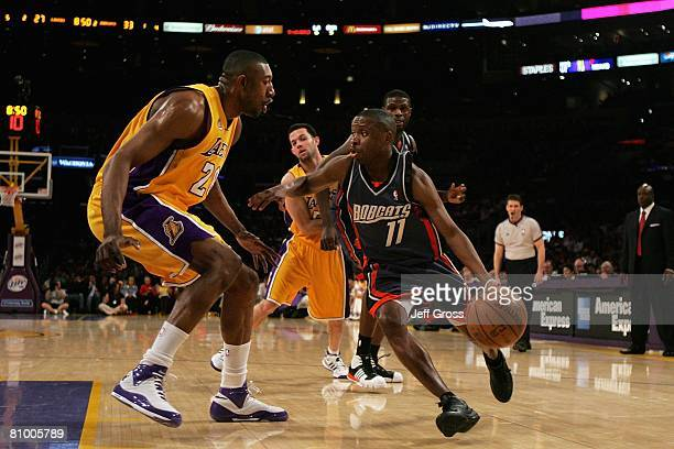 Earl Boykins of the Charlotte Bobcats drives to the basket against Didier Ilunga-Mbenga of the Los Angeles Lakers on March 26, 2008 at Staples Center...
