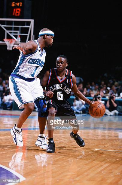 Earl Boykins of the Cleveland Cavaliers moves the ball against Baron Davis of the Charlotte Hornets during the game on February 9 2000 at Charlotte...