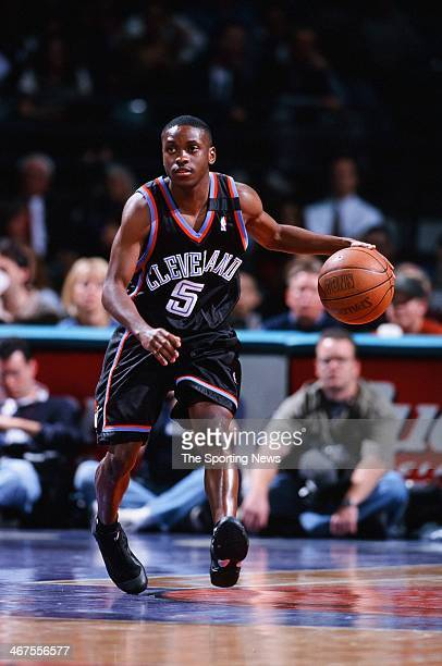 Earl Boykins of the Cleveland Cavaliers moves the ball during the game against the Charlotte Hornets on February 9 2000 at Charlotte Coliseum in...