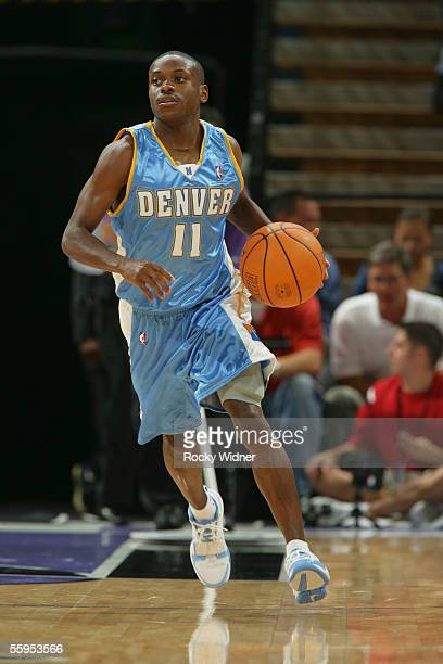 Earl Boykins of the Denver Nuggets brings the ball up court against the Sacramento Kings during a pre season game against the Denver Nuggets at the...
