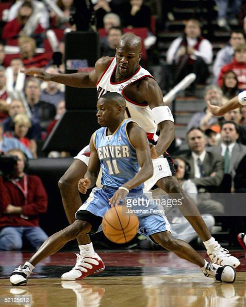 Earl Boykins of the Denver Nuggets dribbles against Ruben Patterson of the Portland Trail Blazers on February 2 2005 at the Rose Garden in Portland...