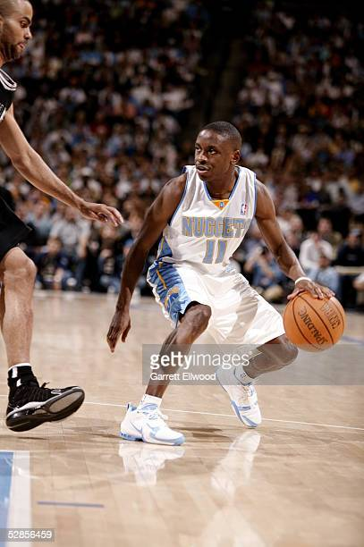 Earl Boykins of the Denver Nuggets dribbles against the San Antonio Spurs in Game four of the Western Conference Quarterfinals during the 2005 NBA...