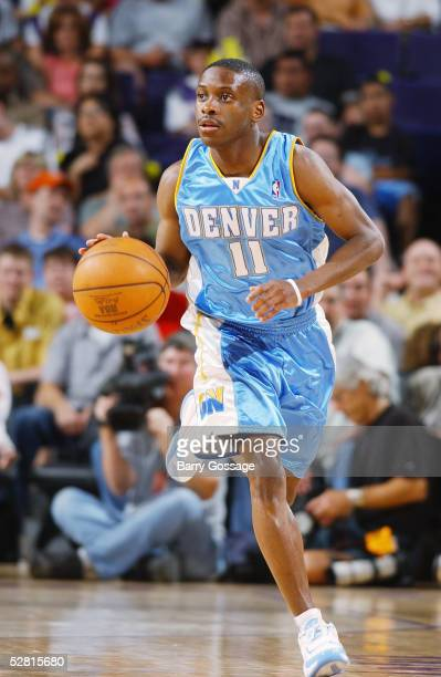 Earl Boykins of the Denver Nuggets dribbles upcourt against the Phoenix Suns on April 18 2005 at America West Arena in Phoenix Arizona The Suns won...