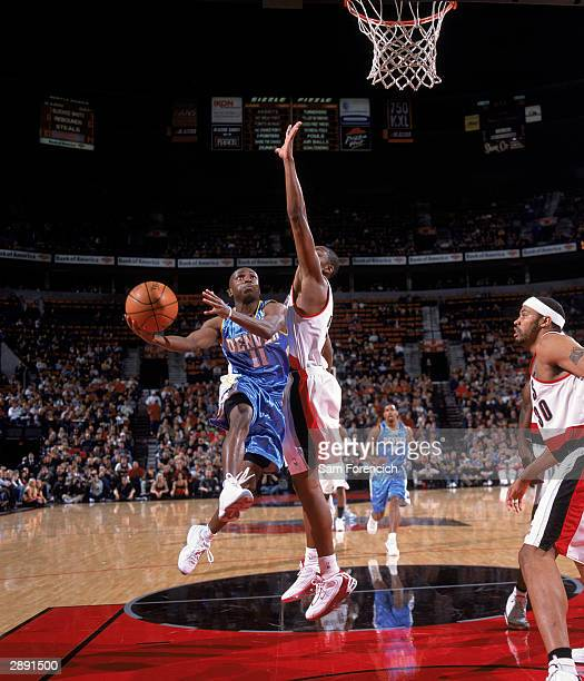 Earl Boykins of the Denver Nuggets drives to the basket against Wesley  Person of the Portland 698ea8a1f
