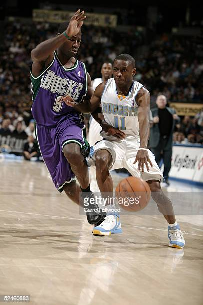 Earl Boykins of the Denver Nuggets goes to the basket against Anthony Goldwire of the Milwaukee Bucks on March 20, 2005 at the Pepsi Center in...