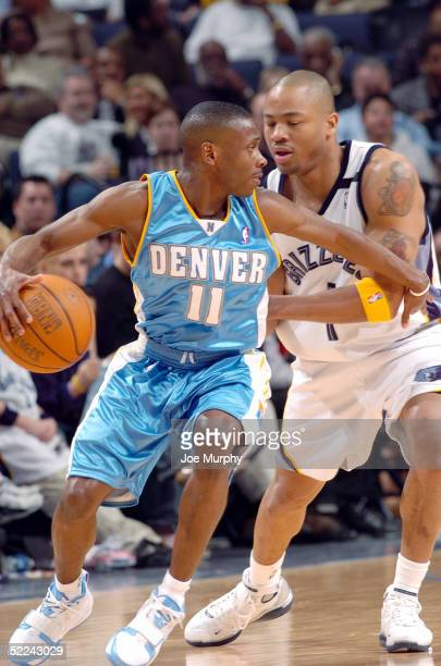 Earl Boykins of the Denver Nuggets handles the ball as Antonio Burks of the Memphis Grizzlies guards him at FedexForum on February 25 2005 in Memphis...